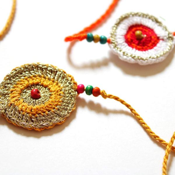 Sattviko Elite Rakhi Gift Hamper - 1 Artisan Crochet Rakhis+1 Designer Rakhi with Roli & Moli + Chocolate Gur Chana + Caramel makhana